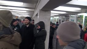 The police pushed the protesters out of the underpass near subway stock footage