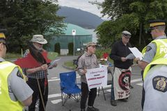 Police read the injunction to Kinder Morgan pipeline expansion protesters. Kinder Morgan protesters against pipeline expansion listen to the reading of the royalty free stock image