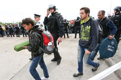 Police and refugees at border crossing Royalty Free Stock Photo