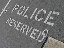 Police reserved as text on asphalt, security,. Police reserved as white text on asphalt, security details Royalty Free Stock Images