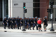 Police in Riot Gear. Police men and women in riot gear patrolling Stock Photography