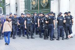 Police in riot gear await orders during a protest Royalty Free Stock Image