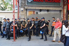 Police in riot gear await orders during a protest. ISTANBUL - MAY 18, 2014 - Police in riot gear await orders during a protest demonstration near Taksim Square Royalty Free Stock Image