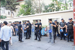 Police in riot gear await orders during a protest. ISTANBUL - MAY 18, 2014 - Police in riot gear await orders during a protest demonstration near Taksim Square Stock Image