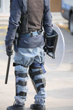 Police in riot gear with batons and protective shield during a p Royalty Free Stock Photography