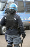 Police in riot gear with blue helmet and truncheon in Itay Royalty Free Stock Image