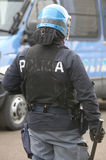 Police in riot gear with blue helmet and truncheon in Itay Stock Photography