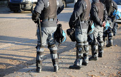 Police in riot gear with flak jackets and protective helmets and. Italian police in riot gear with flak jackets and protective helmets and batons billy Royalty Free Stock Photo