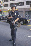 Police in riot gear holding weapon, downtown Los Angeles, California Stock Photos