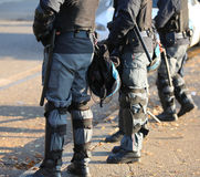 Police in riot gear with protective helmet during the urban revo. Lt of the protesters in the city Stock Photography