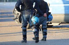Police in riot gear with protective helmet waiting for the fans. Police in riot gear with helmet waiting for the fans of the soccer teams before the important Stock Photography