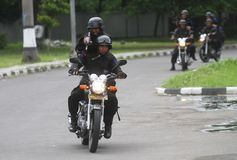 Police riot simulation. Police officer riding motorcycle in a riot simulation in solo, central java, indonesia Stock Photography