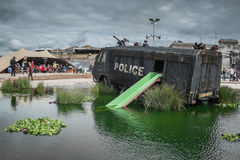 A police riot van in Water Cannon Creek at Banksys Dismaland. Stock Images