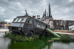 A police riot van in Water Cannon Creek at Banksys Dismaland. Stock Photo