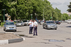 Police road patrol to keep order at the busy intersection of the. MOZDOK, RUSSIA - MAY 9: Police road patrol to keep order at the busy intersection of the city Royalty Free Stock Photography