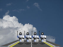 Police roadblock. Bird riot police forming roadblock against a cloudy blue sky Stock Photography