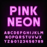 Police rose d'alphabet de tube au néon Dactylographiez les lettres et les nombres sur un fond foncé Photo stock