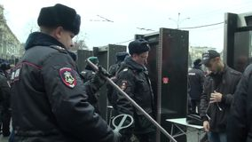 Police searches of members of the opposition March stock video