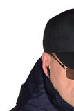 Police security guard staff policeman covertly listening on specop field situation, isolated undercover agent covert operations stock photos