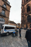 Police security van surveillance of the Christmas Market. In France after Paris Attaks with pedestrians and families walking in tranquility near Notre-Dame Stock Photo