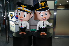 Police in Seoul with the Korean flag royalty free stock photo
