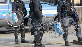 Police with shields and riot gear Stock Image