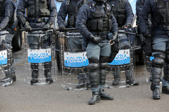 Police with shields and riot gear during the sporting event Stock Image
