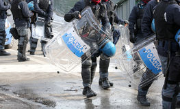 Police with shields and riot gear during the sporting event Royalty Free Stock Images