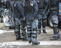 Police with shields and riot gear during the sporting event Royalty Free Stock Photography