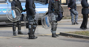 Police with shields and riot gear during the sporting event Stock Photos