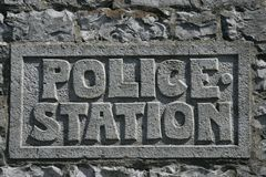 Police sign. Out of stone Royalty Free Stock Photo