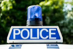 Police sign and blue light on patrol vehicle. Close up of POLICE sign with blue light on the roof of a police patrol vehicle royalty free stock image