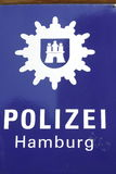 Police Sign with coat of Arms from the Police of the City Hambur. G stock photography