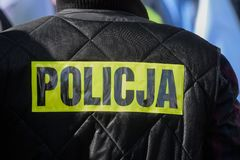 Police sign / logo on the uniform. Police sign/logo on the back of black police uniform jacket royalty free stock images