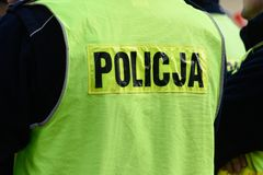 Police sign / logo on the uniform. Police sign/logo on the back of green police uniform west royalty free stock image