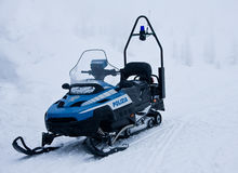 Police snowmobile in the mountains Stock Photos