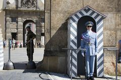 Police and soldier in uniform standing for protection security at front of Prague castle Stock Image