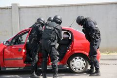 Police squad save kidnapped man tied with handcuffs in the city of Sofia, Bulgaria – sep, 11,2007. Crime scene. Criminals. Terrorists Royalty Free Stock Image