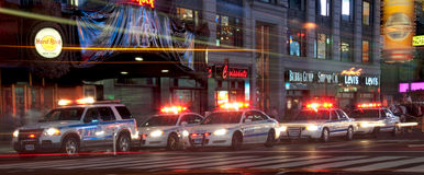Police squad at times square. A night shot of times square with police squad Stock Images