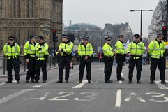 Police Stand Guard on Westminster Bridge Stock Images