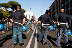 Police standing in front of colosseo Stock Photos