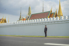 A police standing in front of The Grand Palace road. BANGKOK, THAILAND - OCT 15, 2016 : A police standing in front of The Grand Palace road Royalty Free Stock Images