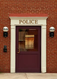 Police station. Door and old fashioned lights Stock Images