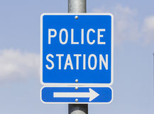 Police Station Sign. Police Station direction sign with blue sky stock images