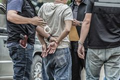 Police steel handcuffs,Police arrested,Police arrested the wrongdoer. royalty free stock photos