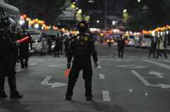 Police on streets at night Royalty Free Stock Image