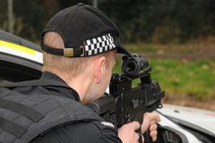 Police SWAT marksman with G36 rifle. Police firearms officer armed with an Heckler and Koch G36C assault rifle. Real Police SWAT Stock Image