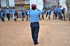 Police Sweeping Street. At Bhaktapur Durbar Square which is one of three Durbar Squares in the Kathmandu Valley in Nepal, all of which are UNESCO World Heritage stock photo
