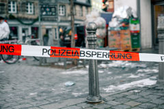 Police tape in Germany at the crime scene with the inscription in German police cordon. Crime Scene. Police tape in Germany at the crime scene with the Stock Photography