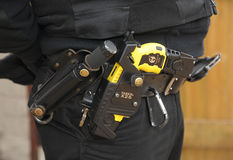 Police Taser gun. Taser X26 ECD (Electronic Control Device) as used by law enforcement officers and armed forces. Taser is classed as a handgun in many countries royalty free stock image